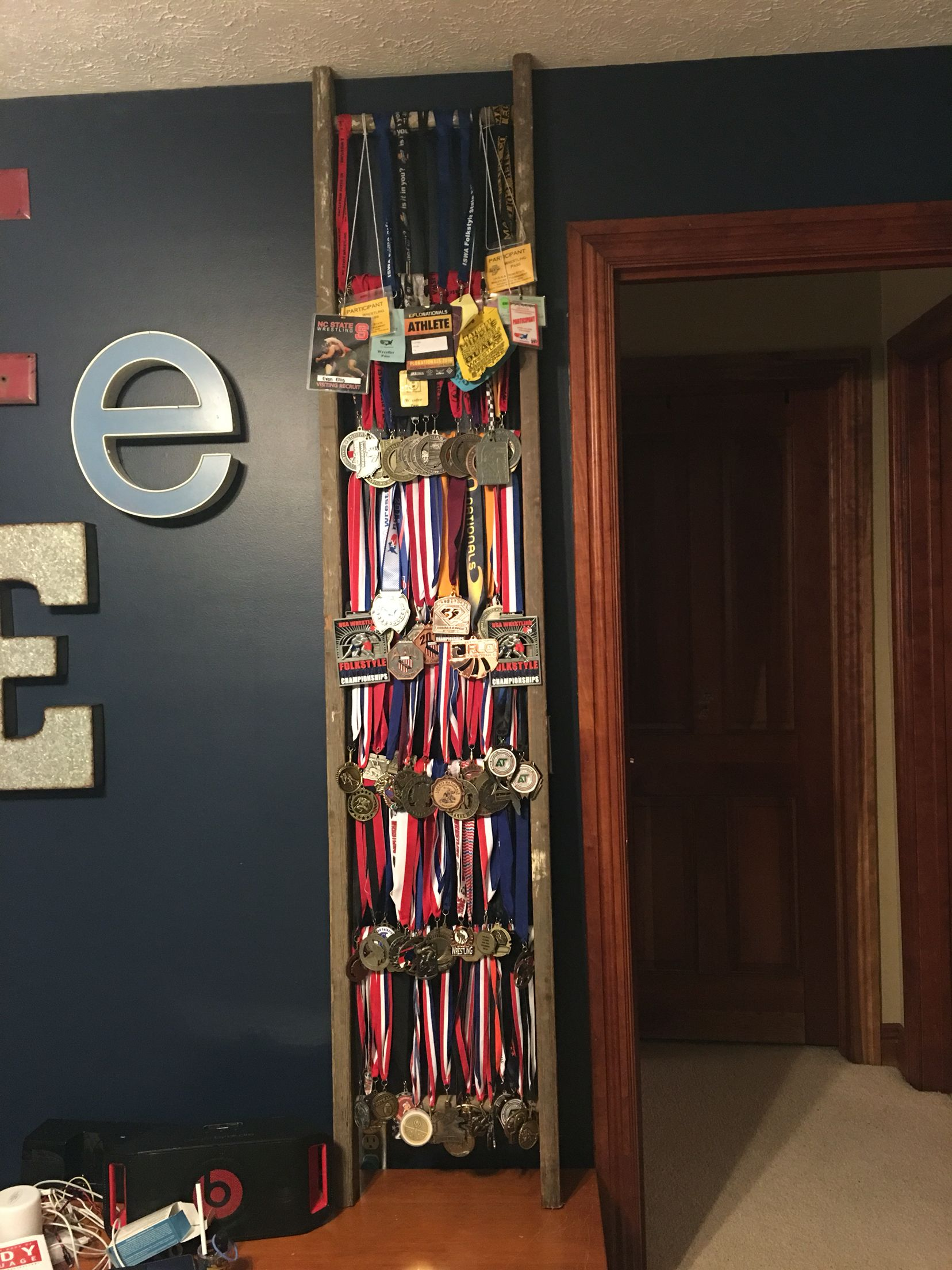 Medal display on an old ladder diy pinterest display for Display bedroom ideas