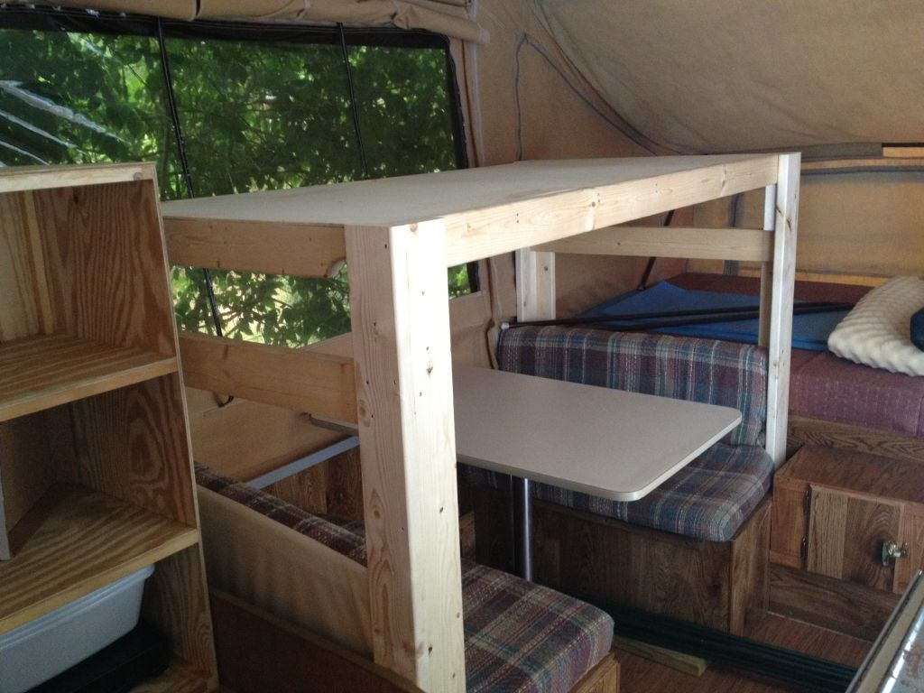 Add a bunk to the dinette to sleep an extra child.