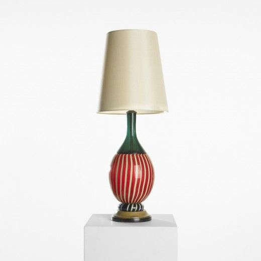Paolo Venini  					table lamp, model 3804      					  						VeniniItaly, c. 1950 lattimo glass with incalmo application, stained oak, silk10 dia x 26 h inches Signed with three-line acid stamp to underside: [Venini Murano Italia]. s10