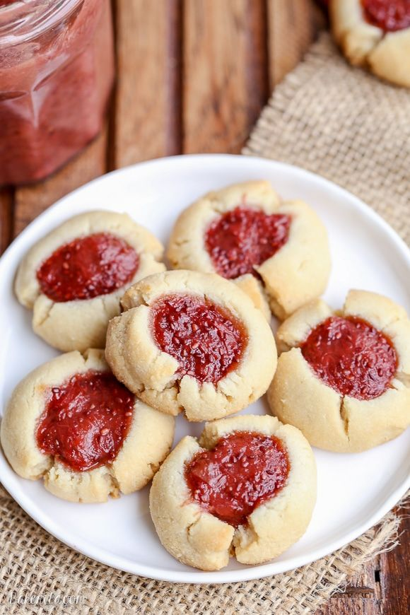 These Jam Thumbprint Cookies are a simple and delicious cookie made with only four ingredients! You won't be able to have just one of these gluten-free, vegan, and Paleo-friendly cookies. #jamthumbprintcookies