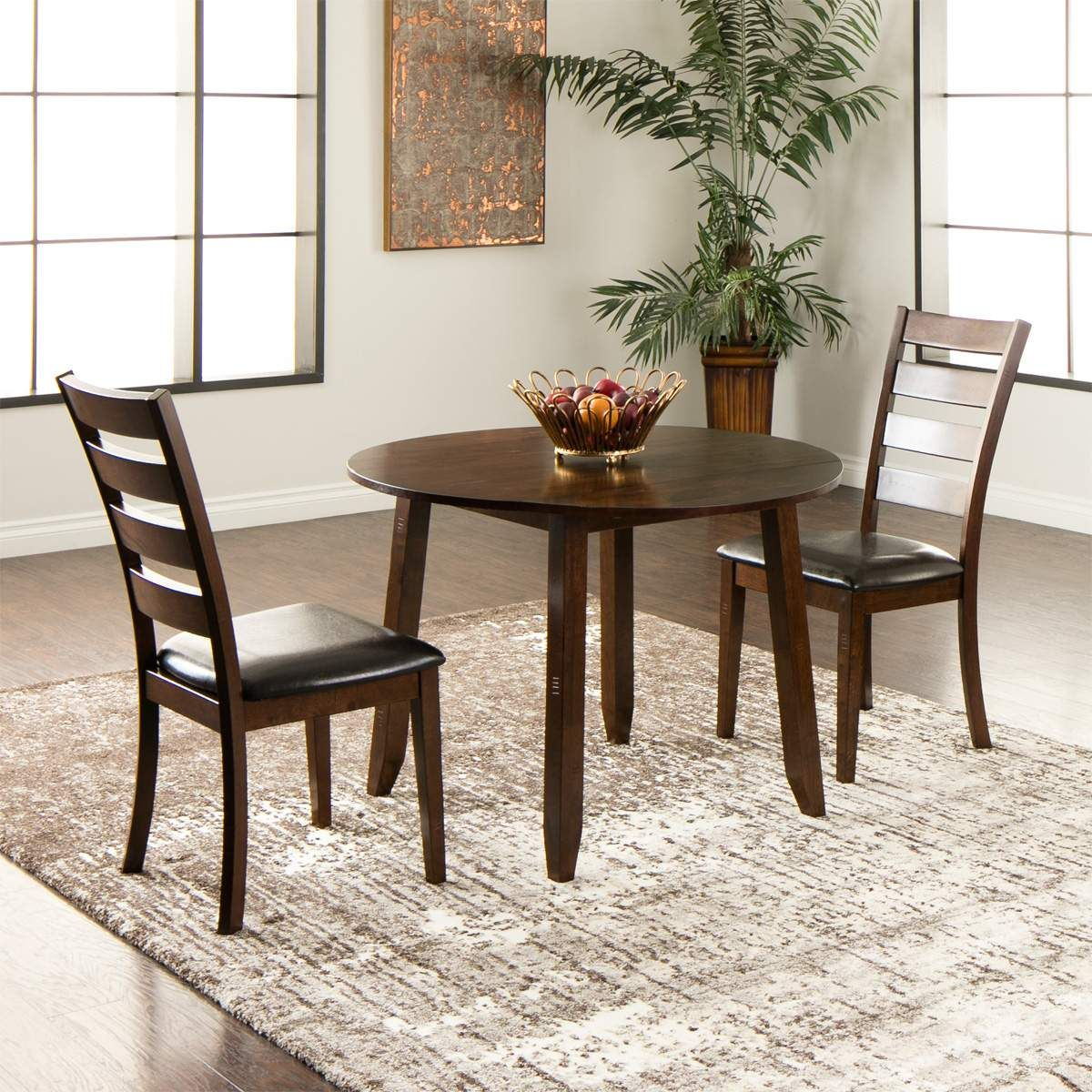 the kona 3 piece dinette set is inspired by traditional cafe designs and constructed of mango wood with veneers the tall ladder back side chair adds an