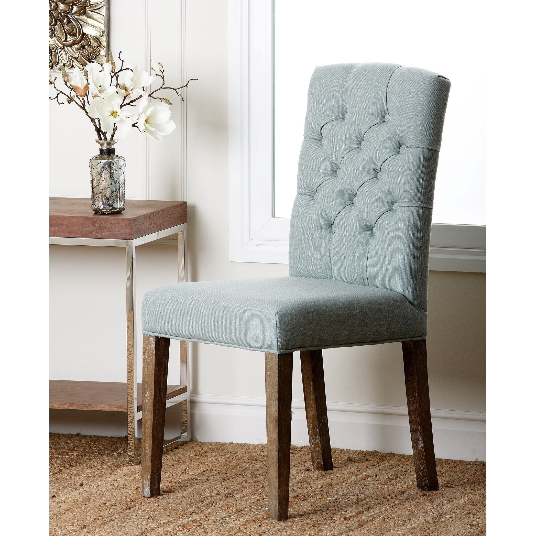 This Classy Chair Features A Light Blue Linen Upholstery