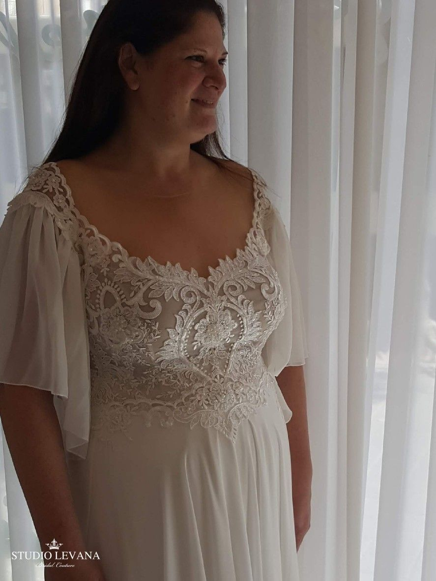 Bohemian Light Plus Size Wedding Dress With Chiffon Flutter Sleeves Valentina Studio Levan Wedding Dresses Wedding Dress Long Sleeve Plus Size Wedding Gowns [ 1182 x 887 Pixel ]