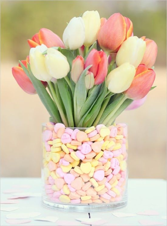 Put together this love-themed centerpiece in a flash with pastel candy hearts and fresh flowers.