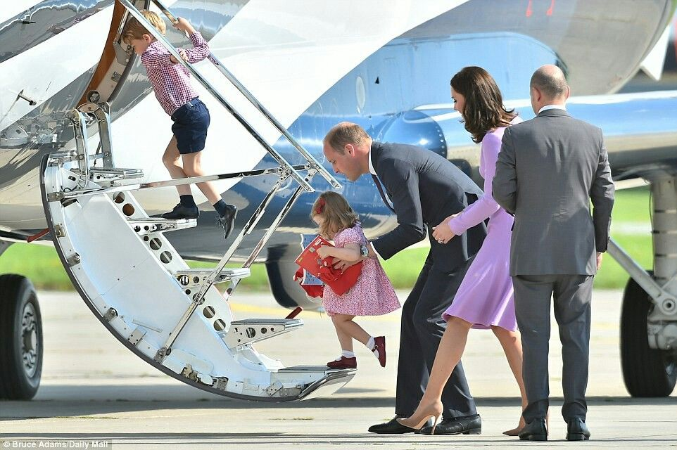 Prince George, Princess Charlotte, William Duke of Cambridge and Catherine Duchess of Cambridge boarding the plane at the  Hamburg Germany airport . July 21 2017