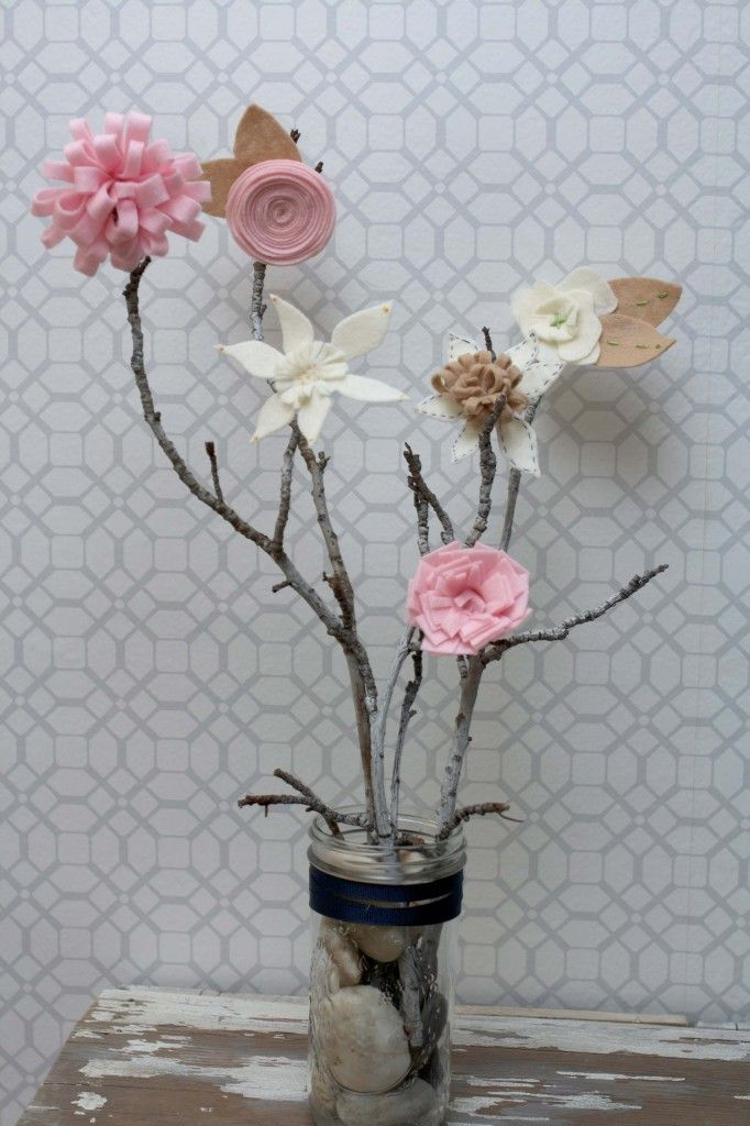 What a beautiful way to display felt flowers!