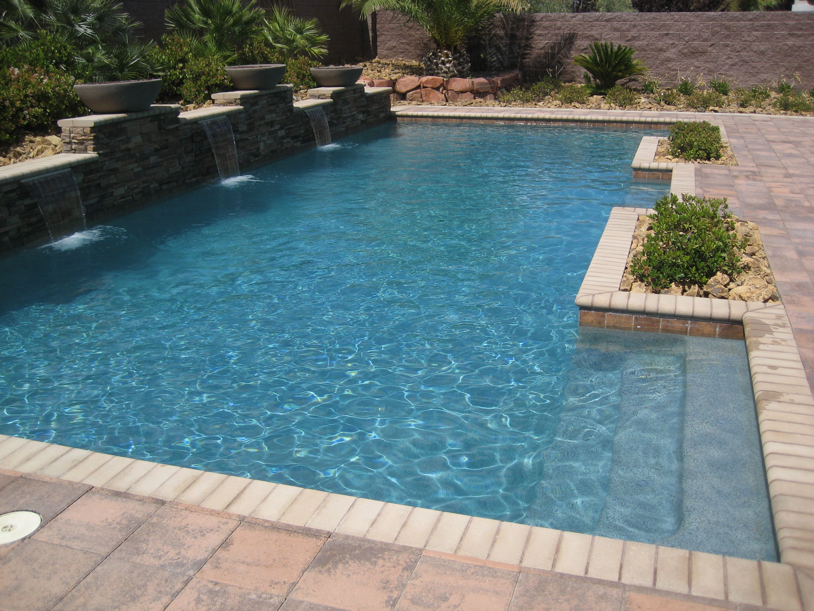 custom swimming pool designs. Custom Swimming Pool Design With Integrated Landscape And Fire-bowls For Nighttime Ambience. Designs