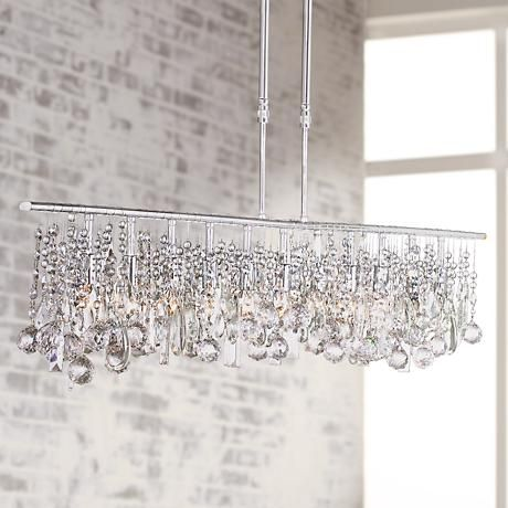 A large modern chandelier design in a classic crystal and chrome ...