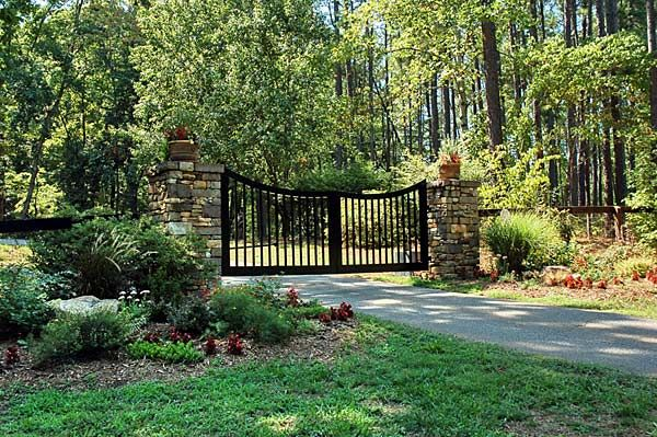 driveway entry gate with stone