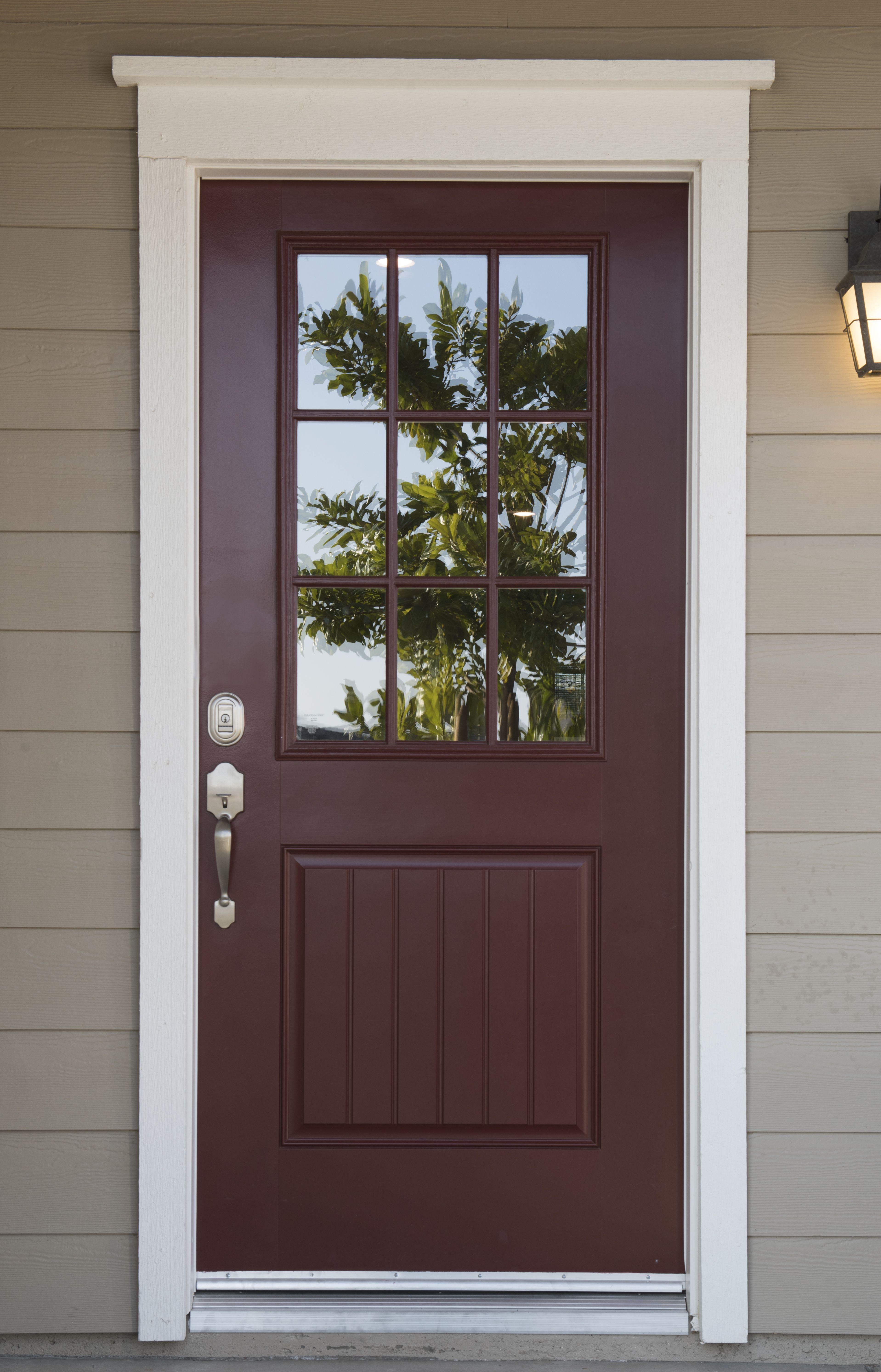 Maroon Color Front Door Gives Off Such A Great Pop With The Added White Trim Painted Front Doors Garage Door Styles Garage Door Design