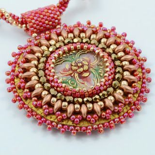 IZZILAND, pale pink beaded pendant.