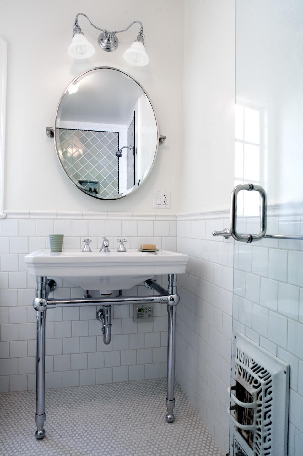 Tile wainscoting bathroom - This Contemporary Guest Bathroom Features White Tile Wainscoting Along The Walls And A Penny Tile Floor