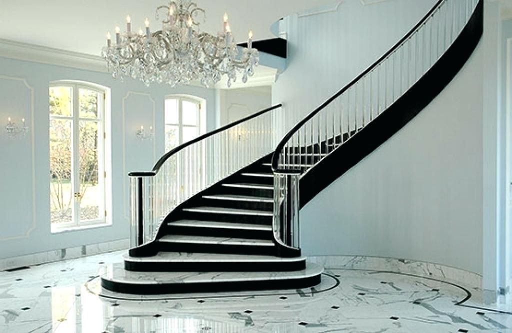 Elegance Starts With A Curved Staircase Made Of Marble And Polished With A Beautiful Chandelier Staircase Design Stairs Design Curved Staircase