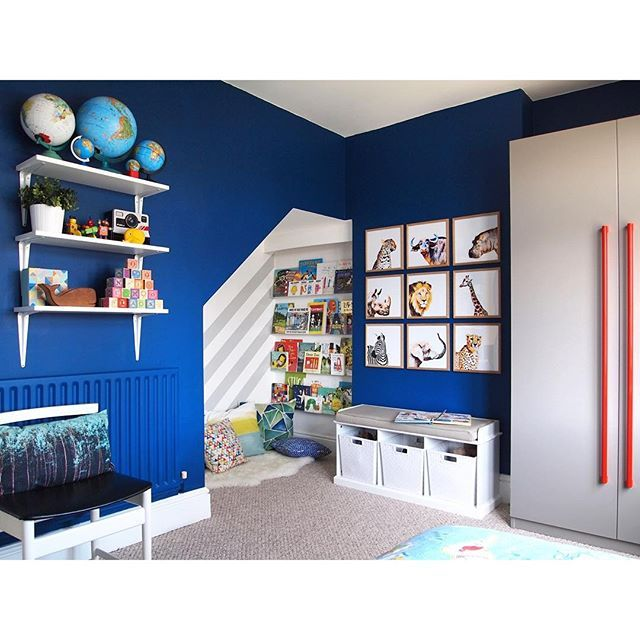 Bold, colourful kid's room. DIY watercolour safari animal art gallery. Walls painted in Little Greene Deep Space Blue, wardrobe in French Grey.