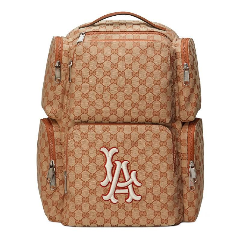 c60d42799c7 GUCCI LARGE BACKPACK WITH LA ANGELS TRADE  PATCH.  gucci  bags  linen   lining  canvas  backpacks  cotton