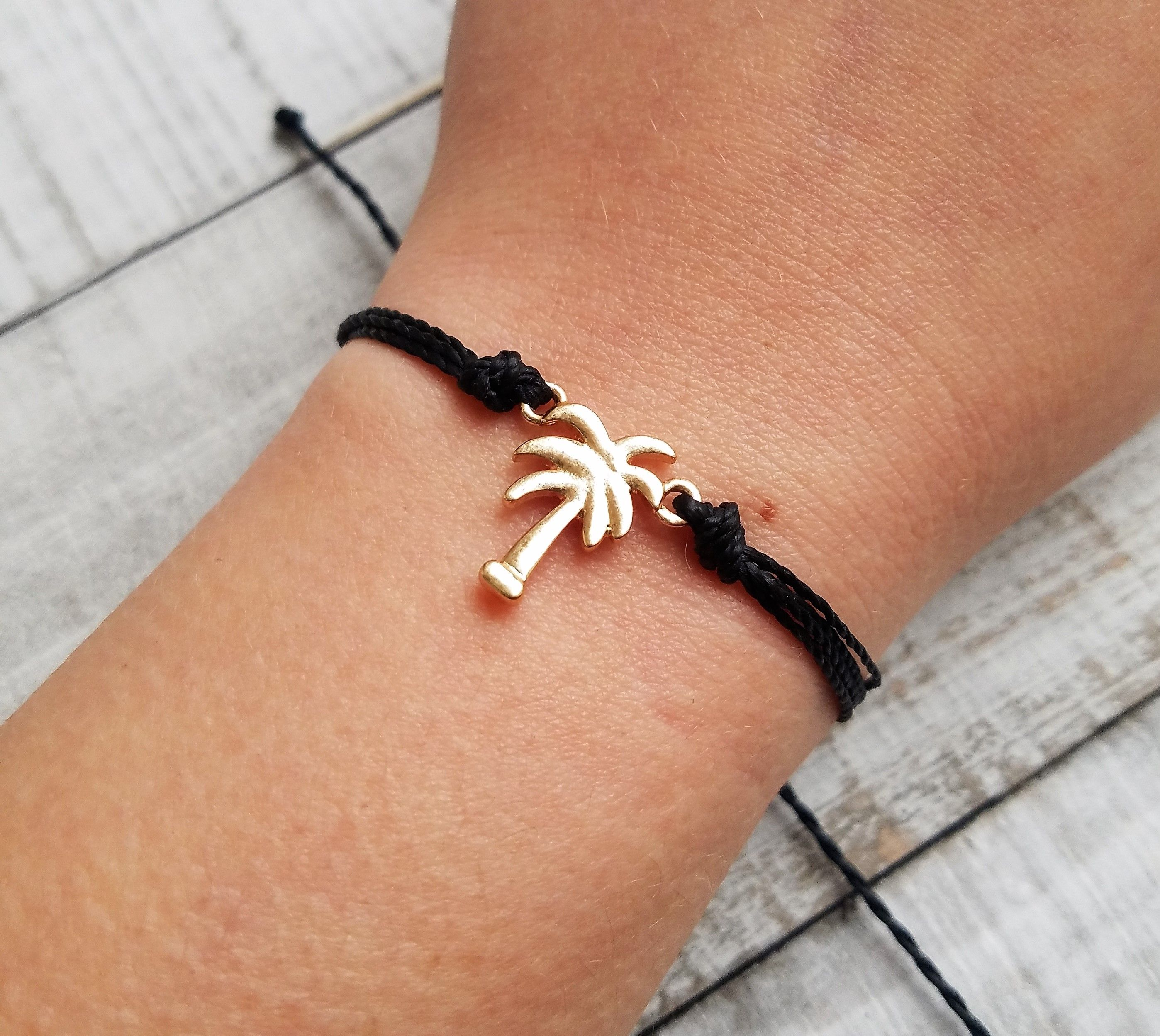 Black and Gold Palm Tree Bracelet available on Etsy @TheBeachnJewelryShop #thebeachnjewelryshop #palmtree #beach #etsyshop