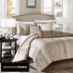 @Overstock - Rollins is a great taupe colored comforter set that offers just a touch of trend through the use of a cheetah inspired jacquard weave subtly woven into a classic stripe.  http://www.overstock.com/Bedding-Bath/Madison-Park-Rollins-7-piece-Comforter-Set/6344813/product.html?CID=214117 $74.99