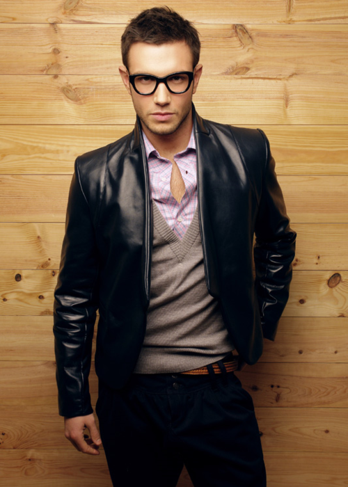 Leather jacket over dress shirt and sweater; perfect look