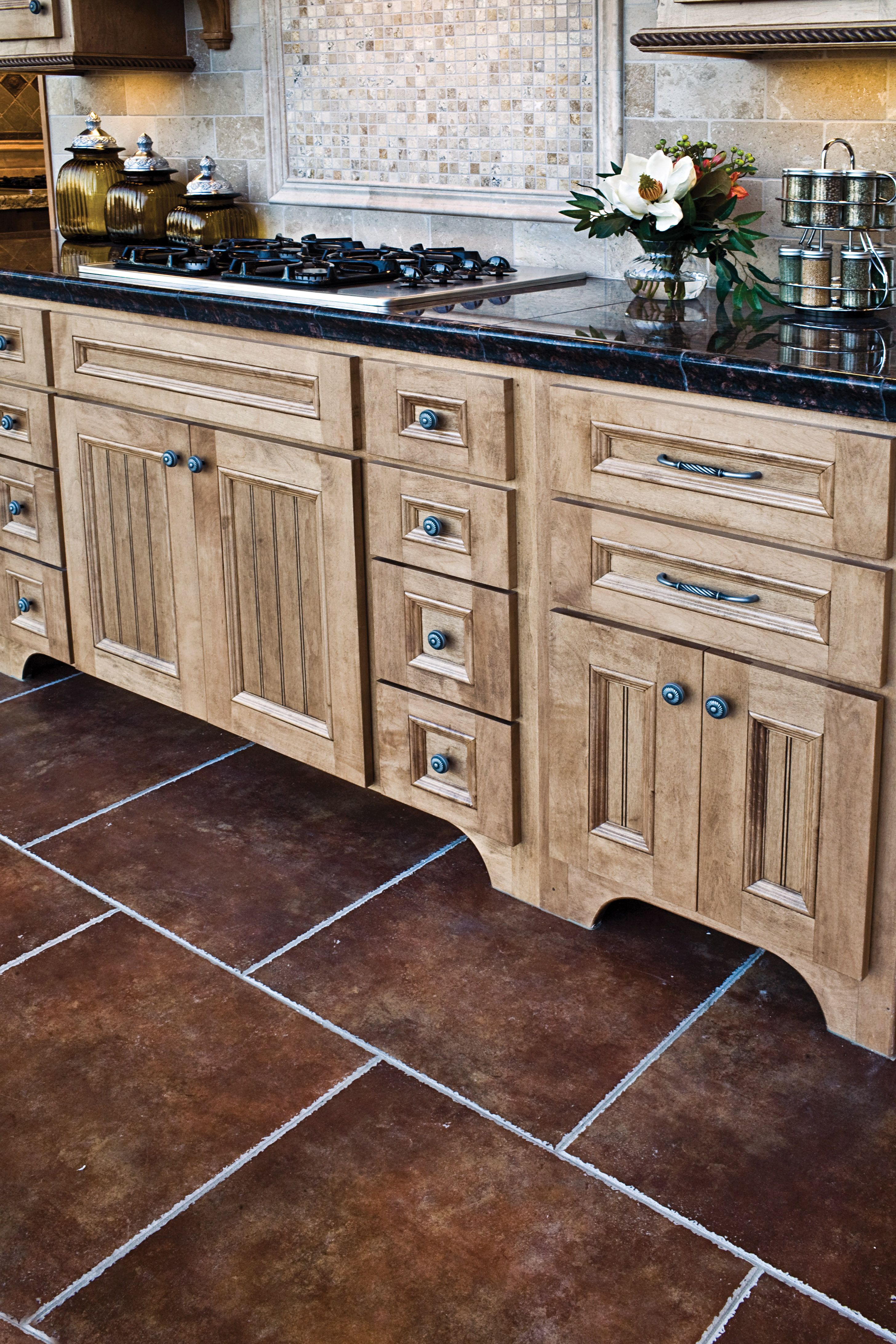 Traditional tiled kitchen travertine backsplash granite