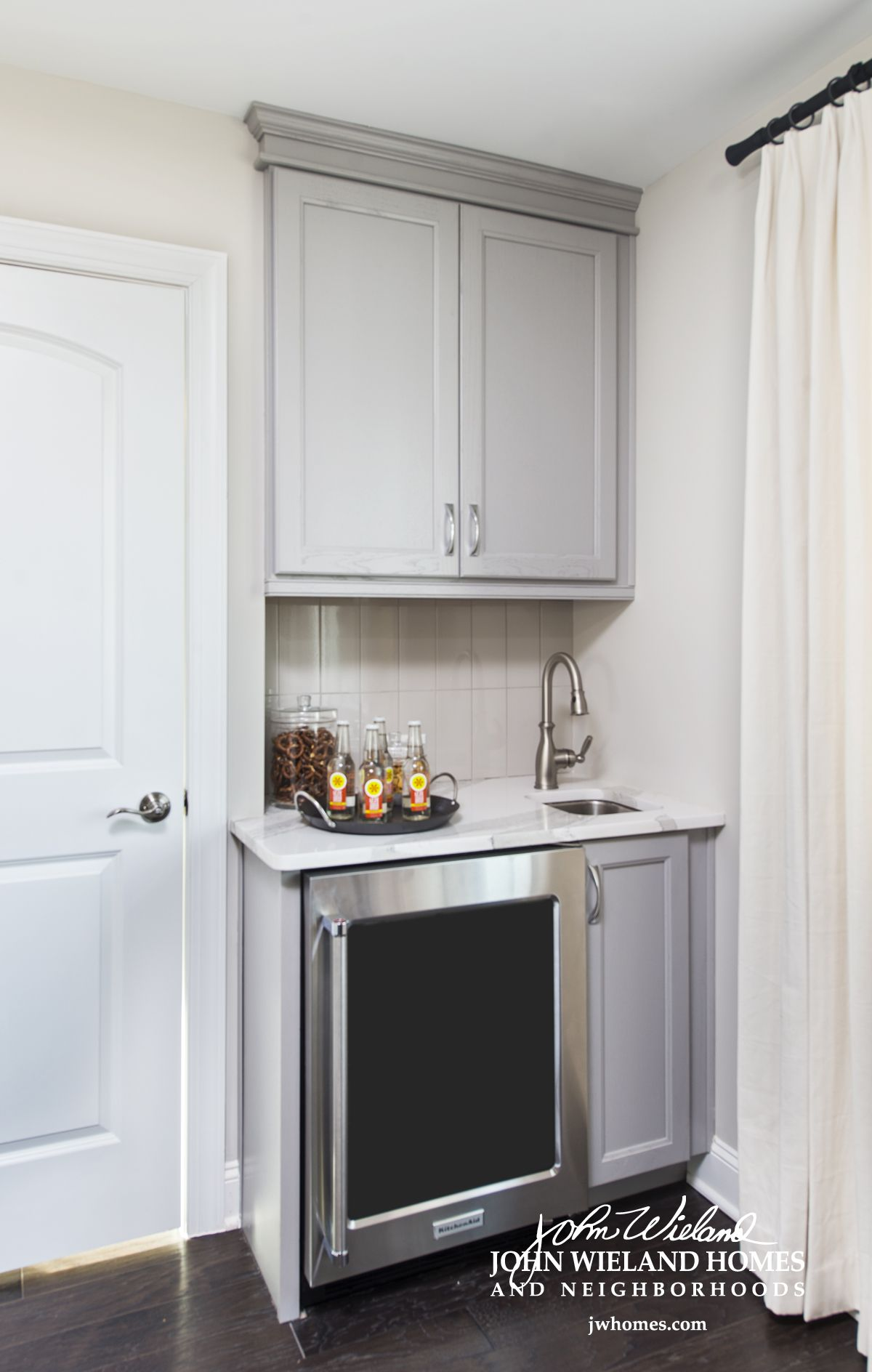 A Built In Mini Bar In The Upstairs Bonus Room Is Perfect For Keeping Refreshments Close At Hand Mini Bar White Room Decor Bonus Room