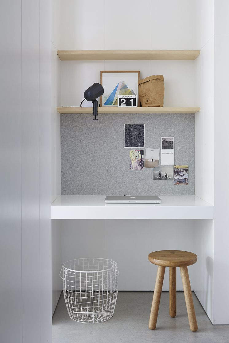 neatly fitted noticeboard between desk and shelf space great for space saving when working from