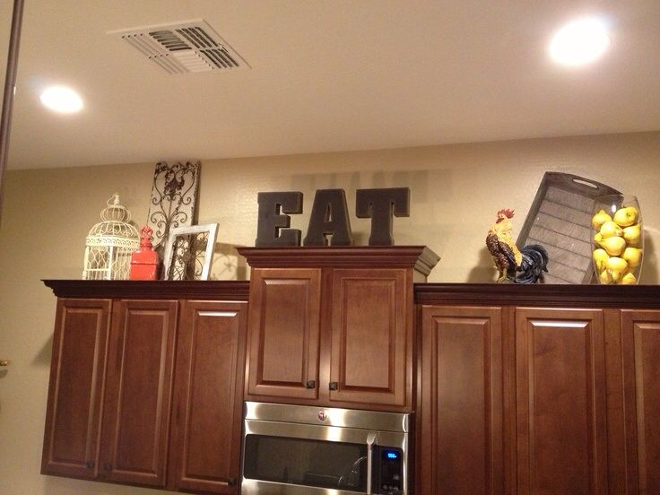 kitchen farmhouse decor above cabinets