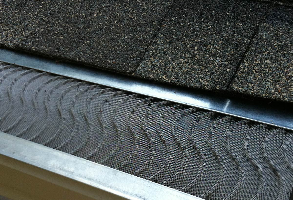 Standing Guard Against Clogged Gutters Clogged Gutter Gutter Guard Gutters