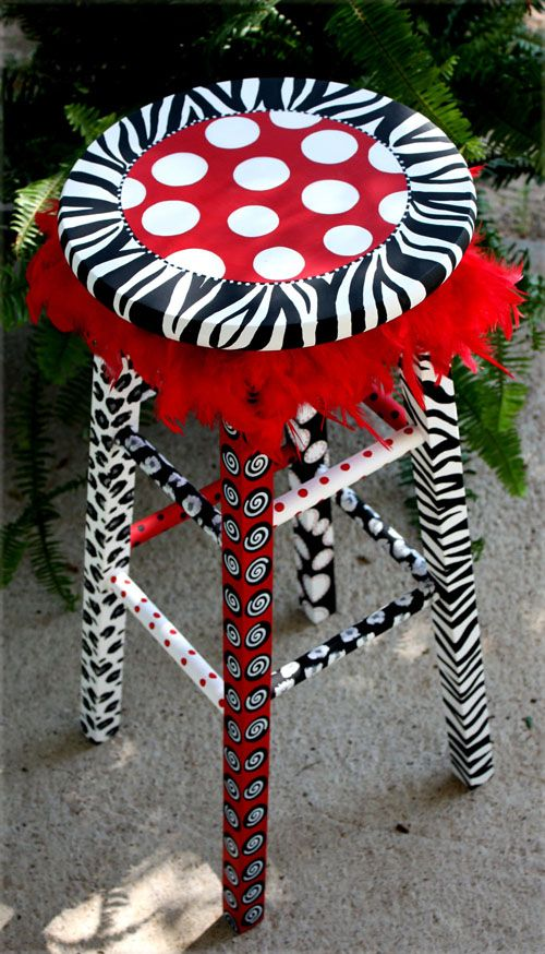 Can't decide on a pattern to paint? Use 'em all... and what the heck, add a little feather boa to the mix. Why not? Using a new-to-you stool, you can play around with your furnishings...