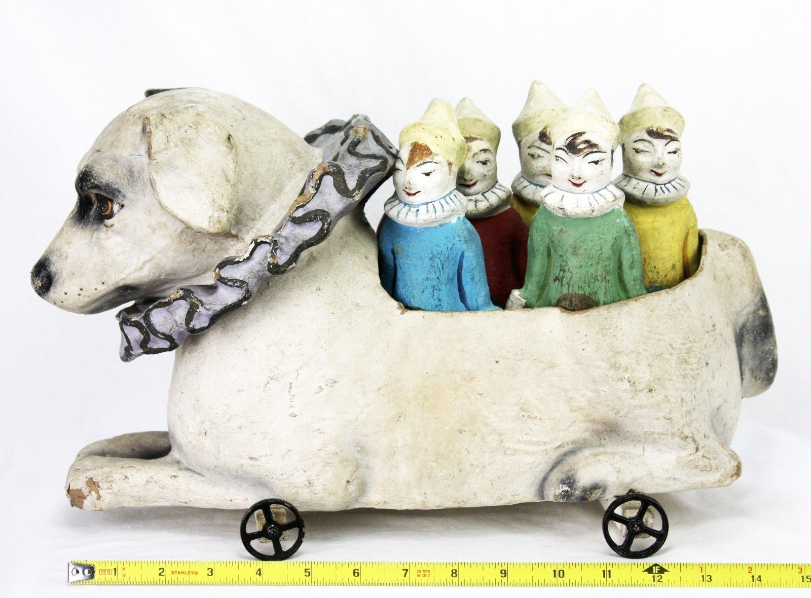 "Paper Mache Circus/Carnival Dog with Cast Iron Wheels holds 6 Painted Paper Mache Skittles. Original Ball Included. Dog measures approx. 7"" x 16"" x 10"" tall. Skittles are approx. 9"" tall. 