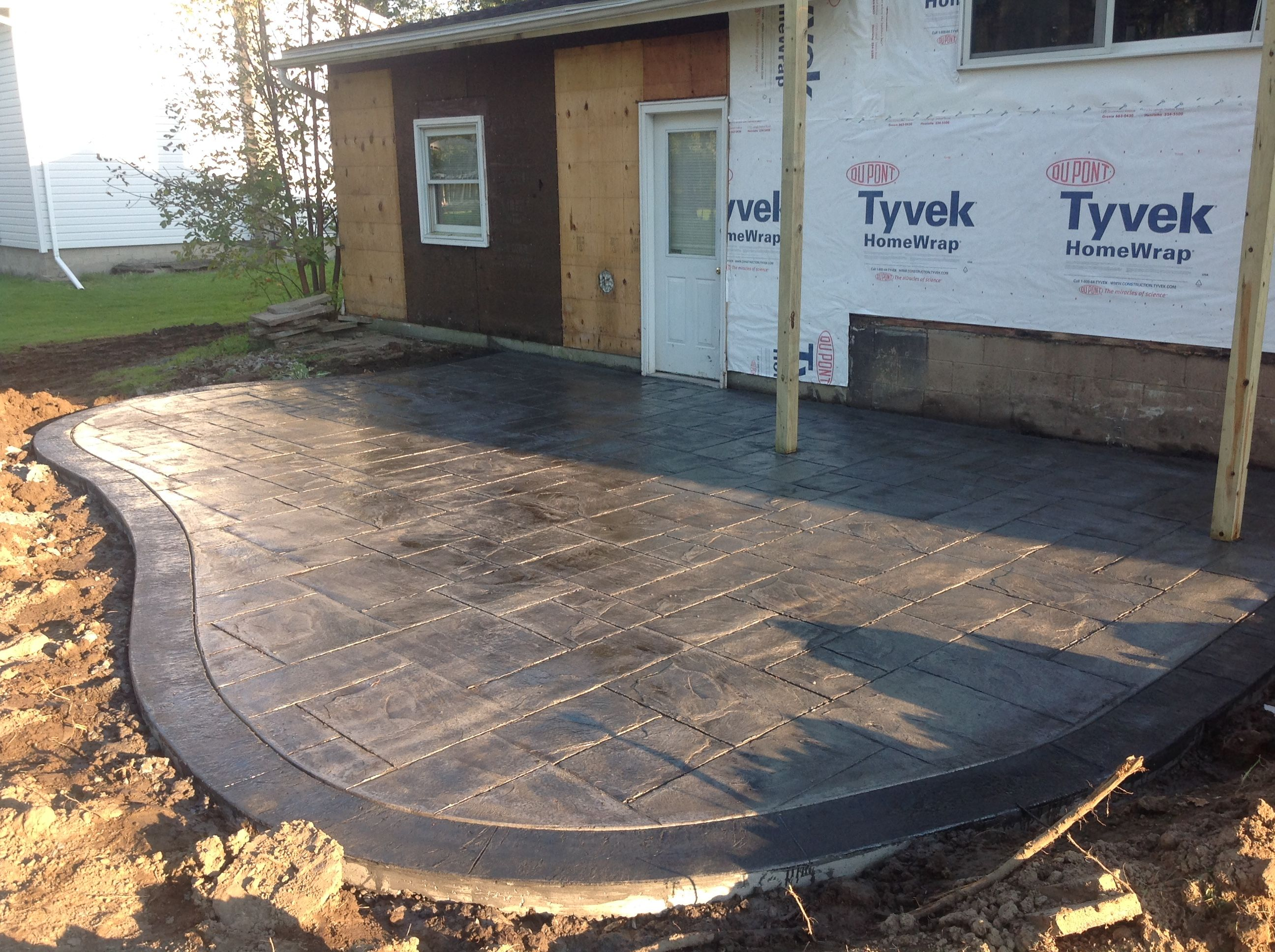 Rochester by stamped concrete patio with a stained border To view