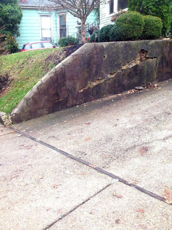 How To Inexpensively Repair A Crumbling Retaining Wall At Your Home Retaining Wall Repair Building A Retaining Wall Diy Retaining Wall