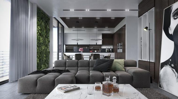 Divano Nero E Bianco : Divano nero imbottito con tavolino di marmo e una cucina a vista