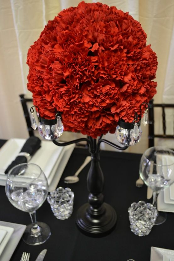 Crystal trimmed black candelabra centerpiece with red