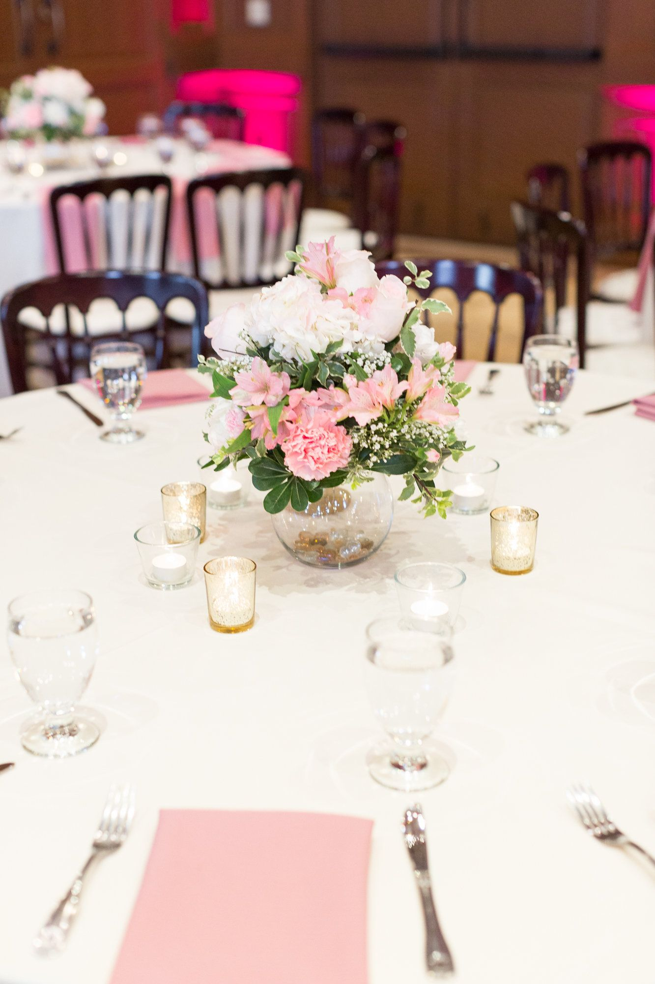Elegant centerpiece with pink car carnations and white hydrangeas ...