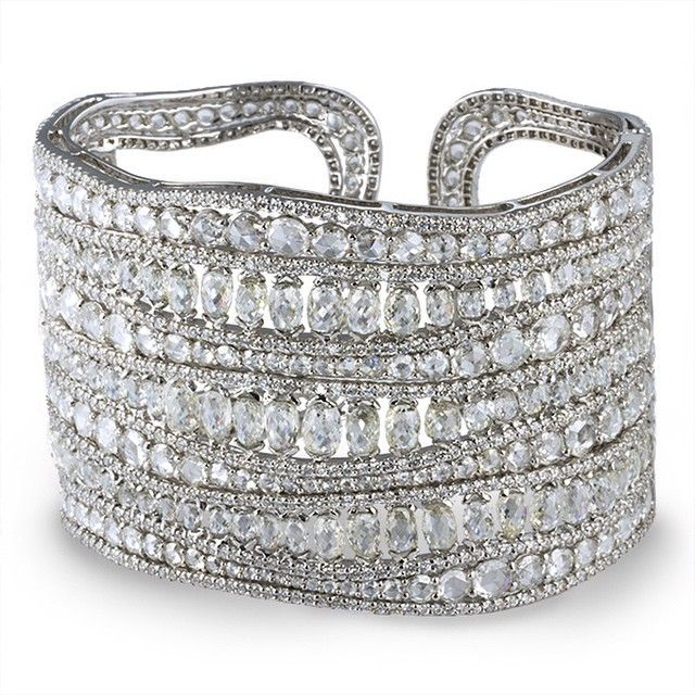 The De Boulle Collection Making Waves Bangle- Swirls of diamonds adorn this bangle in 18K white gold. #deBoulle #deBoulleCollection #Luxury #Jewelry #Love