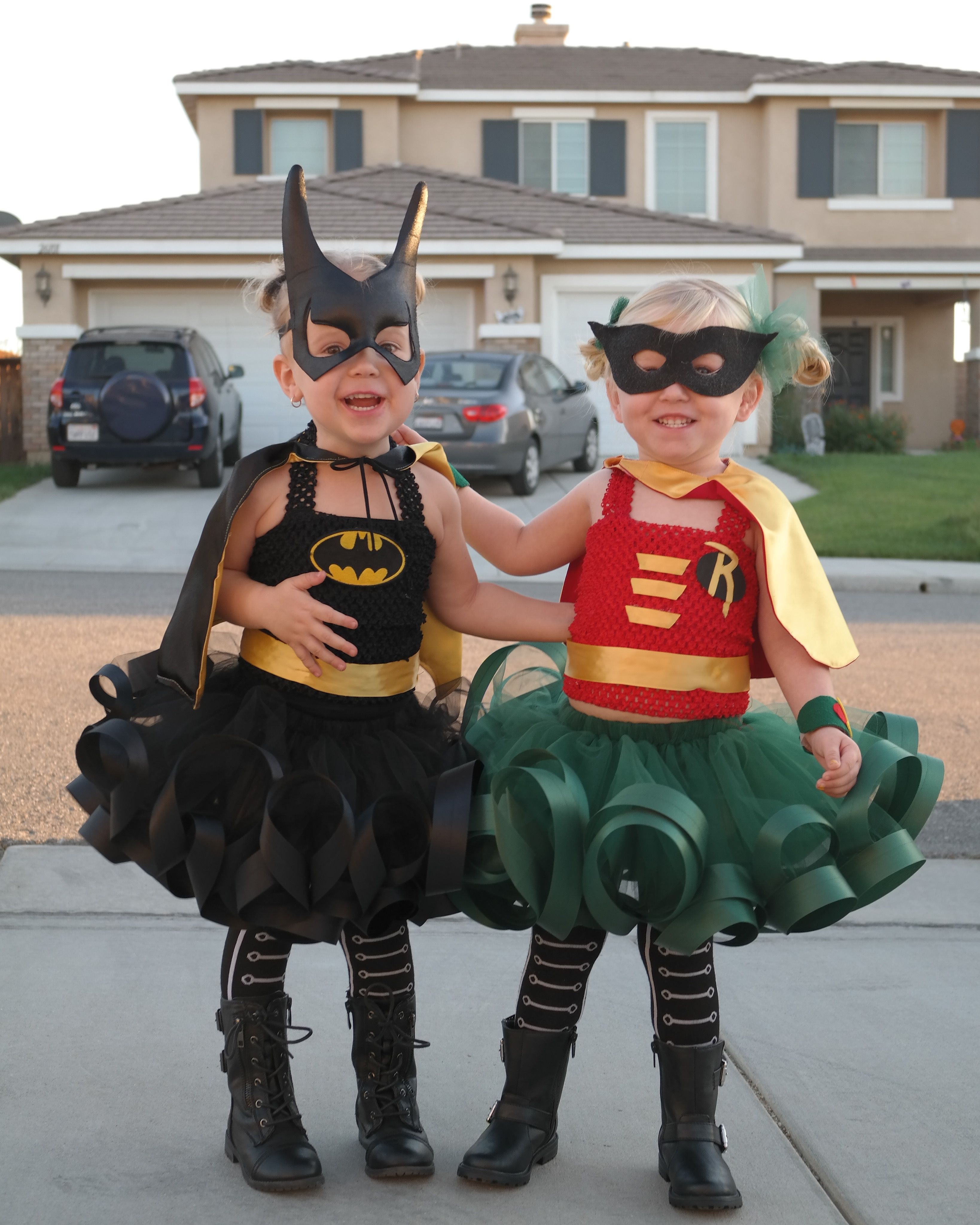 Batman and Robin!  I made the costumes for (BFF's) Andie as Batman (girl)  and Chloe as Robin (girl)