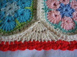 African Flower Cushion with an idea for edging when using hexagonal crochet blocks. Personally, I like the look of a hexagon block afghan but if you don't, this pillow has a great edging but the site doesn't really tell you what to do, you just have to figure it out...looks like 2 rows of treble crochets (row 1: 5 tr, row 2: 2 tr in ea tr from row 1 (10 tr)).