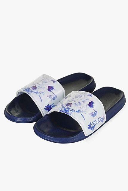 d1f4367b0789 Here s Your Definitive Summer Sandal Shopping Guide. Slydes Porcelain print  slides