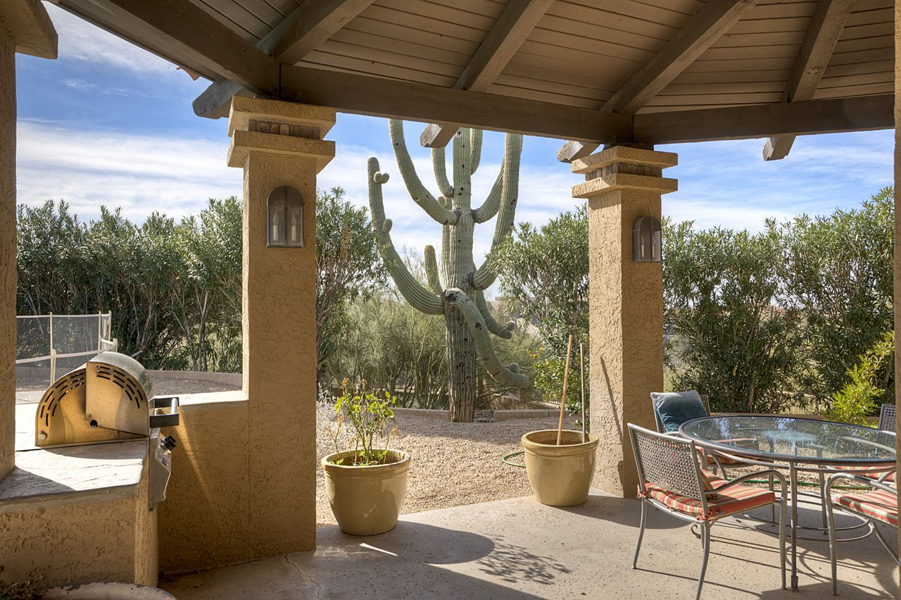 Great view of the natural desert landscaping from this covered patio ...
