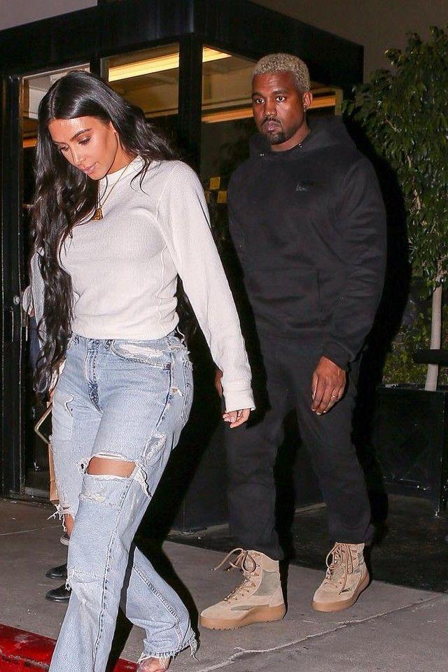 b6cb7e4c5 Kanye West wearing Gosha Rubchinskiy Paccbet Dawn Embroidered Hoodie