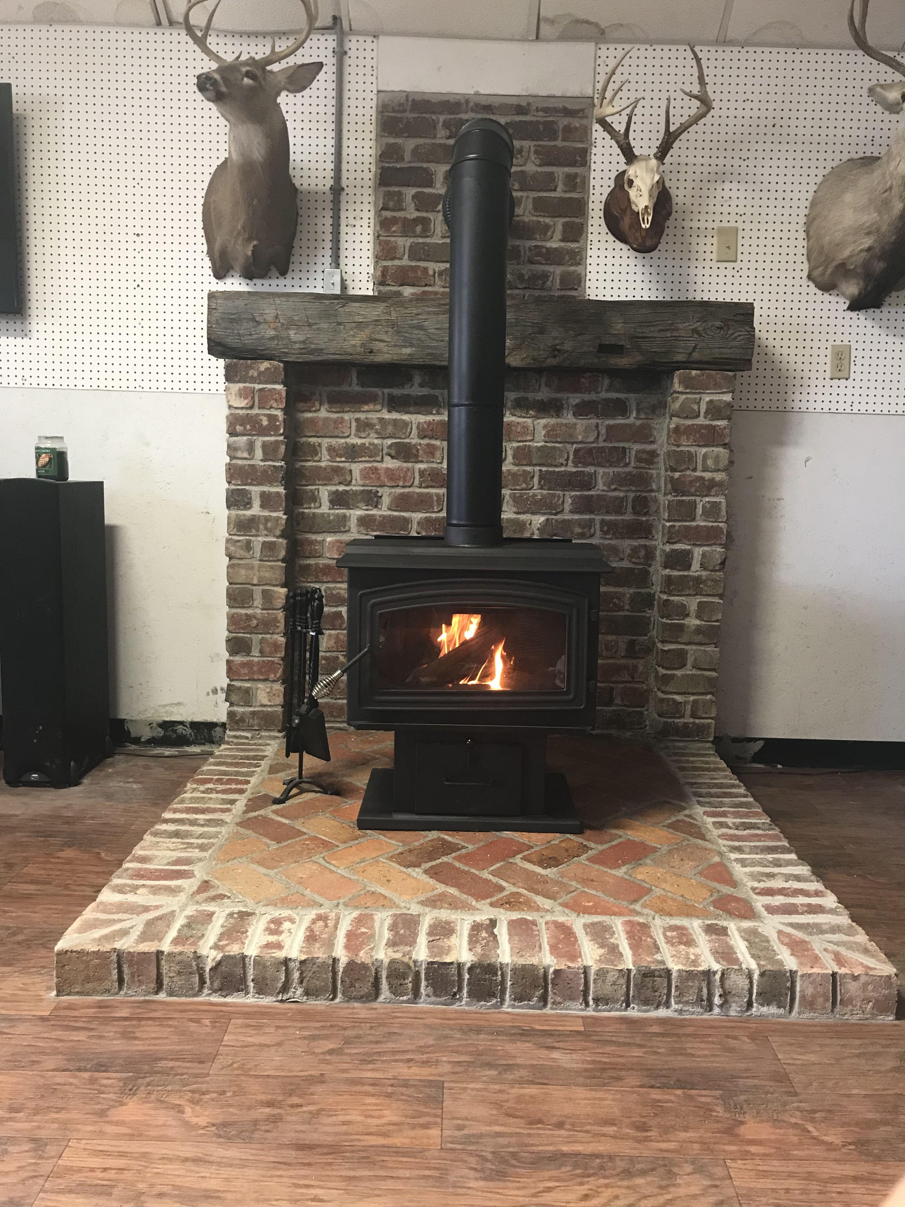 Wood Stove With Brick Surround Herringbone Hearth Pattern And
