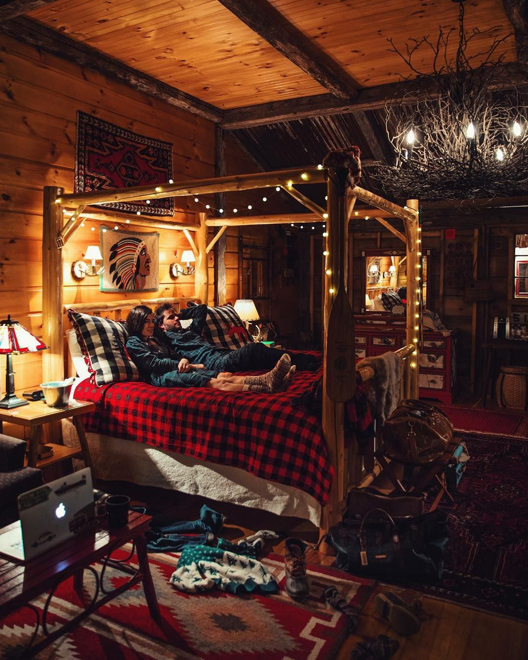 Buffalo check bedding, white string lights, twig chandelier, log ...
