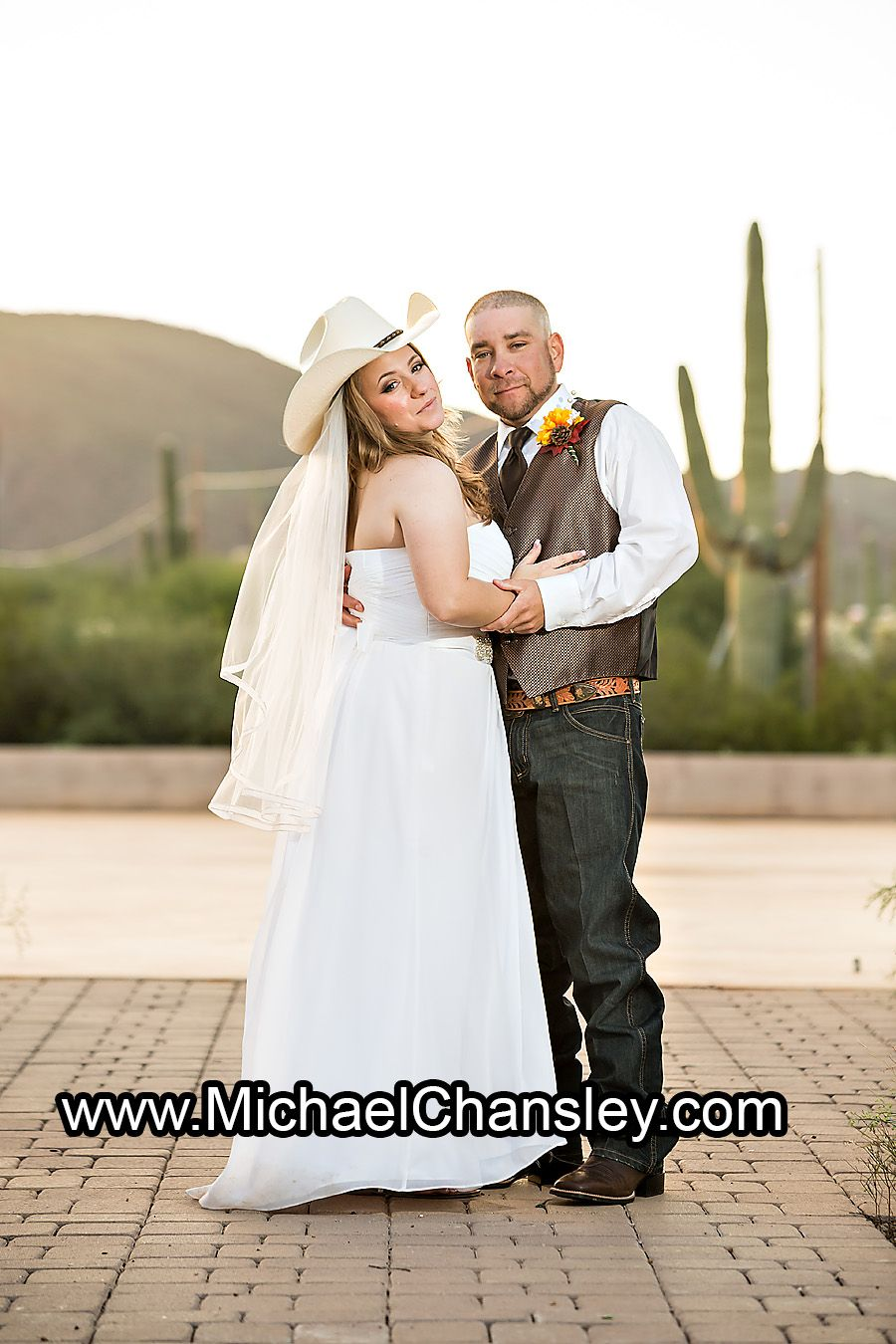 Bride And Groom Posed Portrait With Cowboy Hat At Oasis Wild Horse Ranch Wedding Venue In Tucson AZ Arizona By Michael Chansley Photography