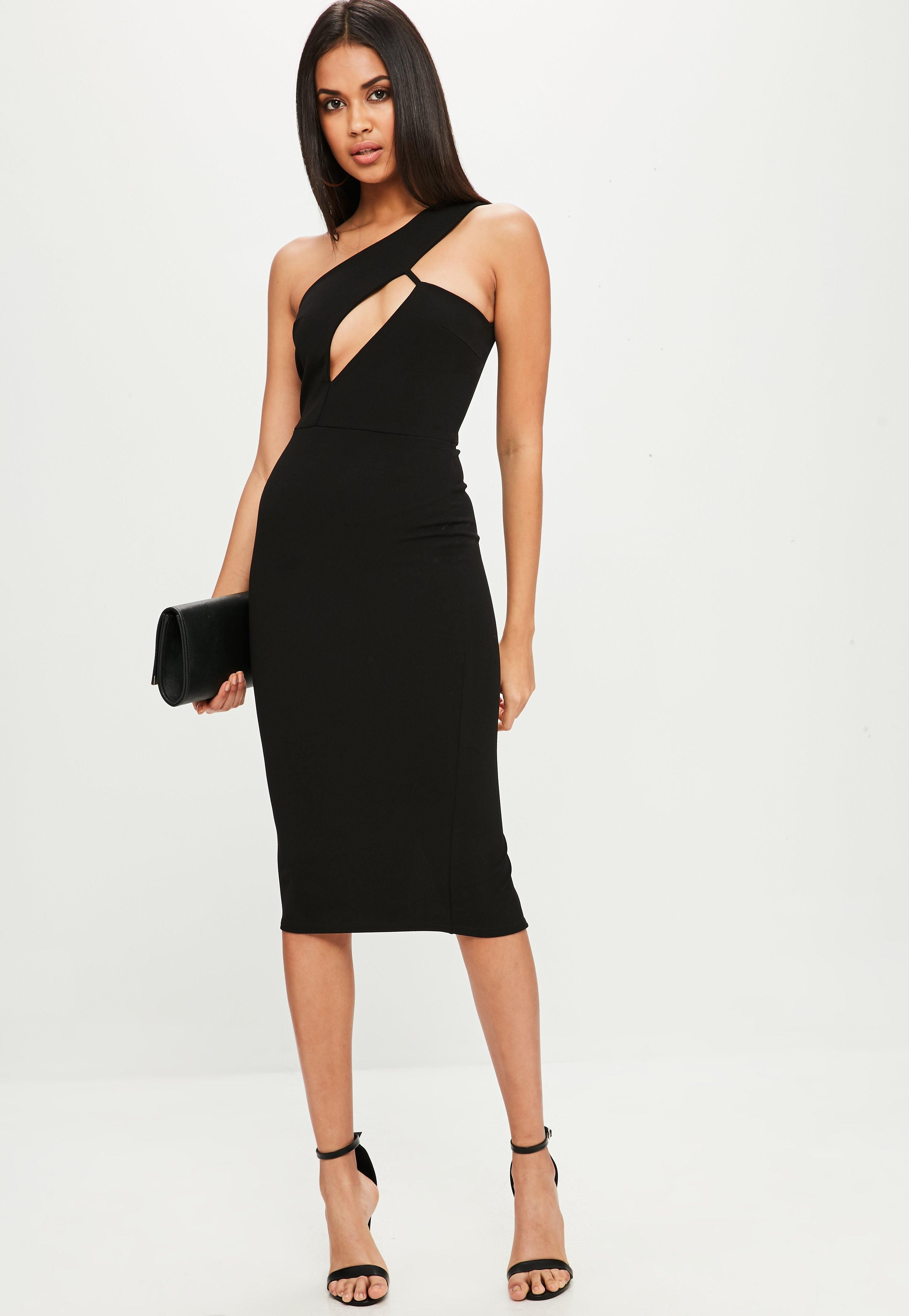 475309a70c46 Black dress with a cut out detailing, one shoulder style and midi length.