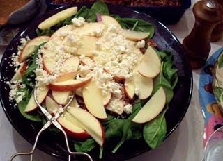 Spinach salad with apples and feta in a cranberry-orange vinaigrette.