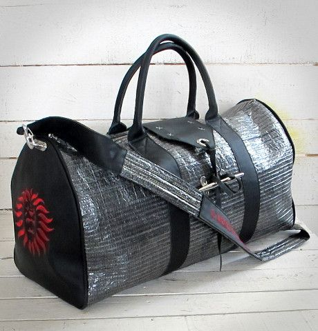 ITA 29  Bag realized with used sails and colored leather. All accessories are marine stuff.