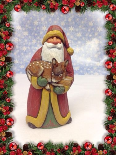 Original hand carved Santa holding fawn by Susan M. Smith