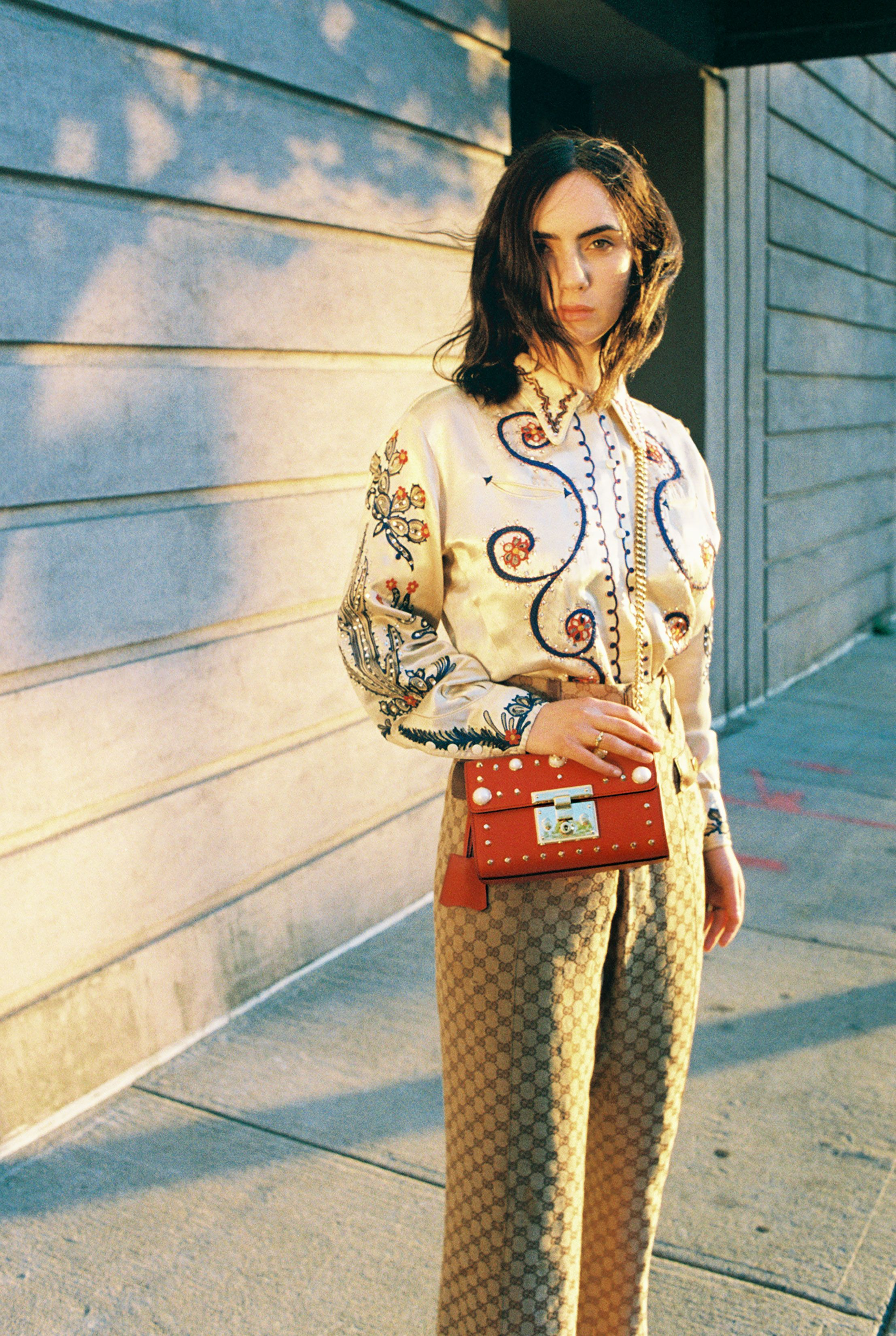 cd55bc57 Zoe Bleu Sidel, 21, in her own vintage shirt, vintage Gucci trousers and  Padlock bag with pearls and studs. Produced by Vogue for Gucci.