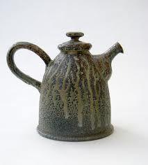 Salt-glazed Teapot by British potter Daniel Boyle. Whimsical & exaggerated handle & spout. via the potter's site