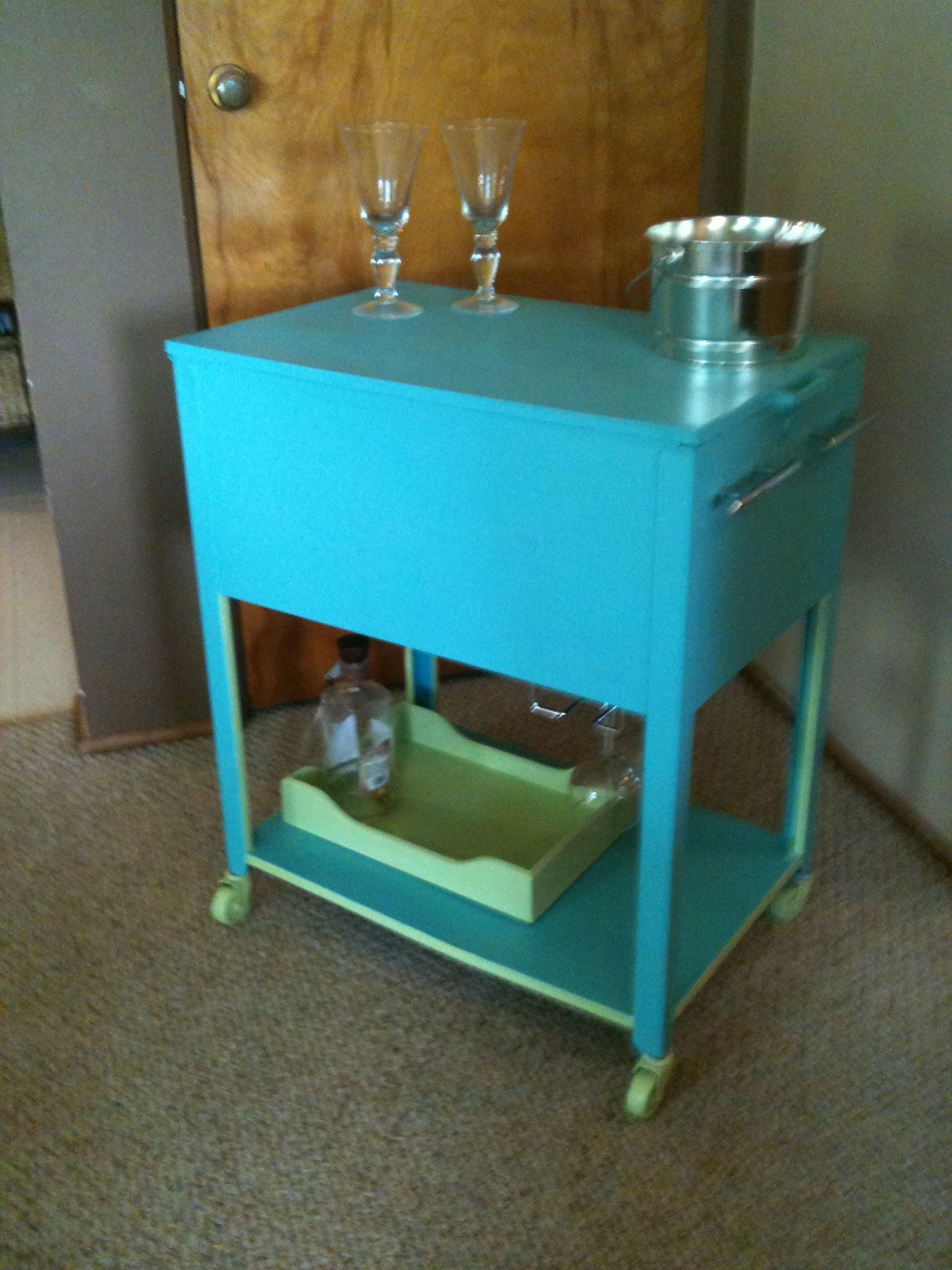 Rolling metal filing cabinet i converted into a drink cart inside is a sherbert orange added wine glass holders underneath sold